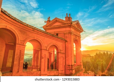 Side view of Sanctuary of Blessed Virgin of San Luca and Colle della Guardia above city of Bologna. Scenic sunset light. Famous landmark cityscape in Emilia-Romagna, Italy.