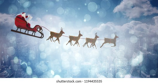 Side view of Santa Claus riding on sleigh during Christmas against aerial view of a city on a cloudy day