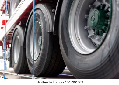 Side View of a Semi-Truck Trailers Three Axles Tyres Stacked on a Trailer