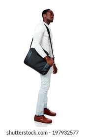 Side view of a serious african man standing with bag over white background
