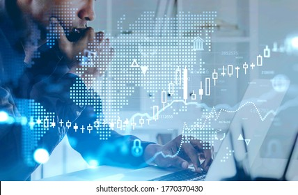 Side view of serious young African American businessman working in blurry office with double exposure of financial graph and digital world map. Concept of investment. Toned image