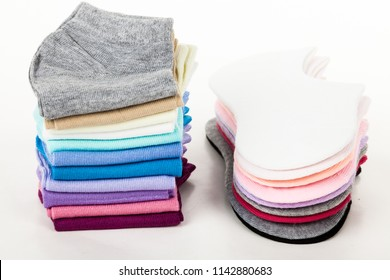 Side view of set of new pairs beautiful unisex stretch blank sock isolated on abstract white background. Nice natural and soft cotton fabric. Wearing and sport clothes concept. Closeup studio shot