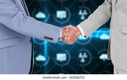 Side view of shaking hands against apps interface