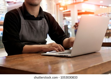 Side view shot of a man's hands typing on laptop keyboard for business or education, Online shopping concept.