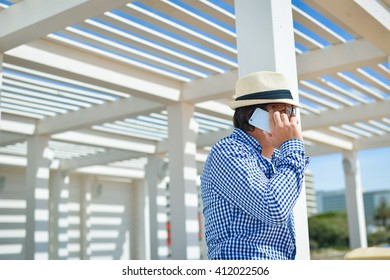 Side view shot of person holding using smartphone on terrace background outdoors