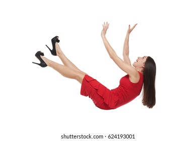 Side view shot of woman falling down. Shouting long-haired brunette falling down
