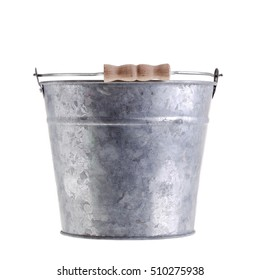 Side view of a small bucket with handle made of metal isolated on white background.