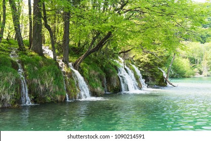 Side view of small waterfalls in Plitvice Lakes National Park in Croatia