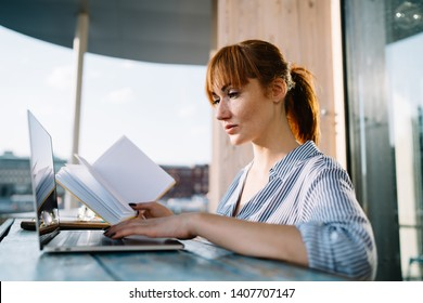 Side view of smart woman spending time for doing college homework in online regime researching information on university website for students, concept of e learning and knowledge education
