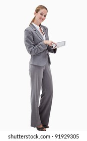 Side view of smiling bank employee using tablet against a white background