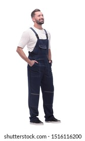 side view. smiling man in overalls looking forward to copy space