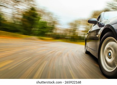 Side view of speeding car.