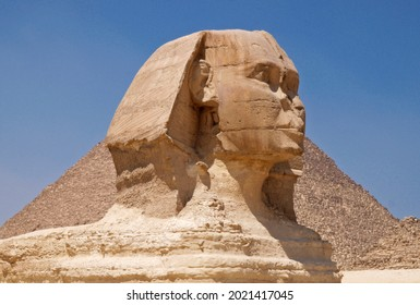 side view of the sphinx in front of the pyramid of giza, Egypt