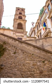 A side view of stairs leading up to a tower, in Sicily, Italy.