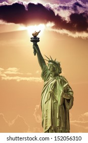 Side view of the Statue of Liberty with beautiful sky.