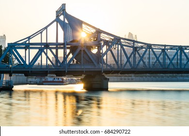 side view of steel bridge against sunset,tianjin,china.