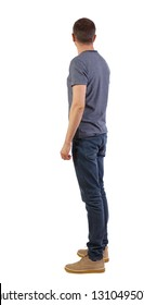 Side view of a stylish man. Rear view people collection.  backside view of person.  Isolated over white background. A young guy is standing and looking sideways.