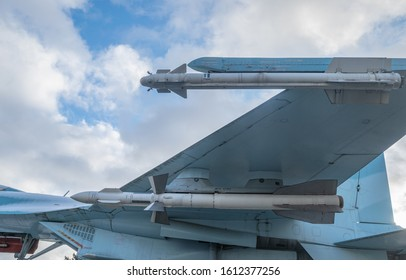 Side view of Su-27 Flanker multirole, supermaneuverable Russian Air Force's fighter aircraft. Close up of wing, hanging R-27, R-73 air-to-air missiles, intake and tail's rudders. Moscow, Russia