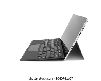 Side view of a tablet computer isolated on white