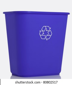 Side view of a tall blue recycling bin isolated on white background.