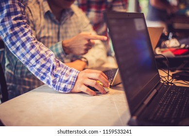 Side view of Teamwork,brainstorming concept.Young creative managers team working with new startup project in modern office. Contemporary notebook on wood table.Horizontal,warm retro tone,copy space.