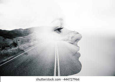 Side view of thoughtful woman's face on road and landscape background. Black and white image. Double exposure