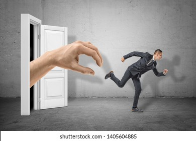 Side view of tiny businessman running from huge hand emerging from doorway behind. Control over employees. Strict corporate policy. Human resources.