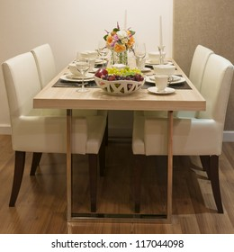 Side view of Top wood Dining Table and White leather chair