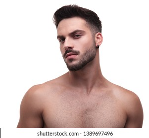 side view of a topless unshaved man looking confident on white background