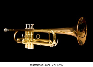 a side view of a trumpet, on black