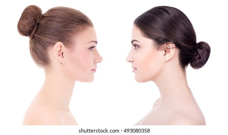 side view of two beautiful women with perfect skin isolated on white background