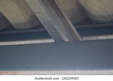 Side view from under at roof steel structures those were had diffrent type such as box steel and c shape steel.They were used as girder or instead of beam to transfer load from above to bottom.