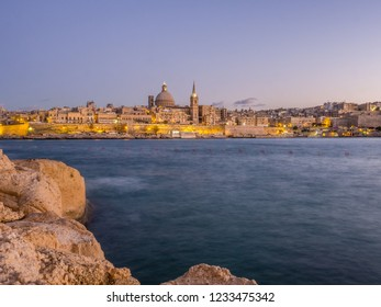 The side view of Valletta city captured during the sunset from Sliema city beach. Sliema, Malta