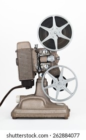 Side view of Vintage 8 mm Movie Projector with Reels. Film is threaded through Projector.