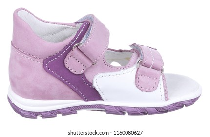 Side view of violet and white suede and leather girl sandal with slits and slots and two velcros, isolated on white