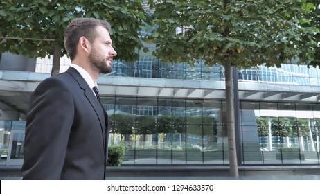 Side View of Walking Businessman