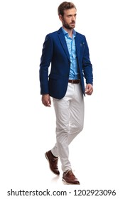 side view of a walking elegant man in blue coat and white pants on white background