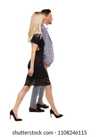 Side view of a walking man and woman in business suits. Rear view people collection. backside view of person. Isolated over white background. Businessman and businesswoman are going to a meeting