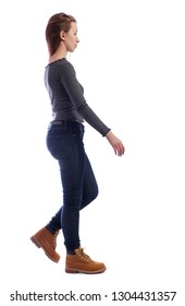 side view of walking woman. beautiful girl in motion. backside view of person.  Rear view people collection. Isolated over white. Sad girl in jeans passes by.