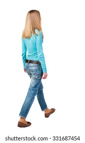 side view of walking  woman in jeans. beautiful girl in motion.  backside view of person.  Rear view people collection. Isolated over white background. Girl in brown shoes go from right to left.