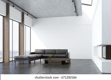 Side view of a white living room interio with a concrete floor, panoramic windows, a fireplace, a long gray sofa and a narrow coffee table. 3d rendering mock up