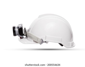 side view of white mining safety helmet with light lamp isolated background