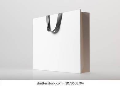 Side view of a white shopping bag on a gray background. 3d rendering mock up