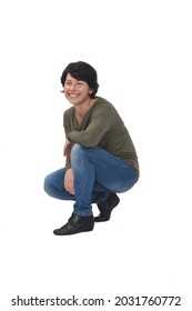 side view of a woman crouching and looking away on white background