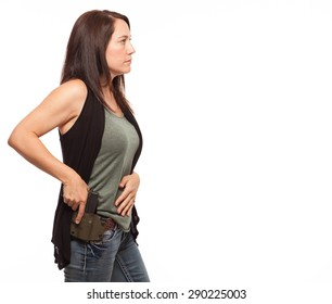Side view of Woman Practicing Gun Safety | Attractive female shooter holding handgun against white background.