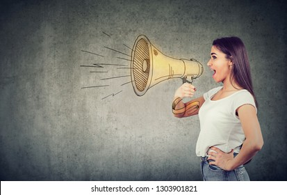 Side view of woman in white t-shirt spreading news and making announcement with loudspeaker.