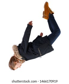 Side view of woman in winter jacket in zero gravity or a fall. girl in parka is flying, falling or floating in the air. Side view people collection. side view of person. Isolated over white background