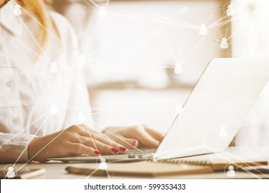 Side view of woman at workplace using laptop with abstract connected staff icons. HR manager concept