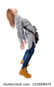 Side view of woman in zero gravity or a fall. girl is flying, falling or floating in the air. side view of person. Isolated over white background. The girl with the bag is strongly leaning back.