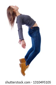Side view of woman in zero gravity or a fall. girl is flying, falling or floating in the air. Side view people collection.  Isolated over white background. The girl in jeans teetering on her toes.